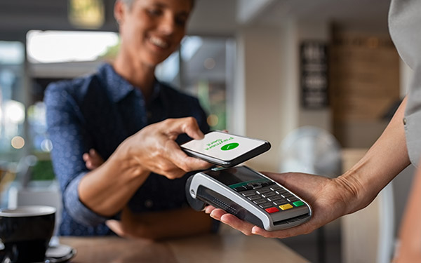Person paying with their cellphone